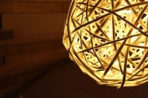 complex woven Christmas ball with lights inside