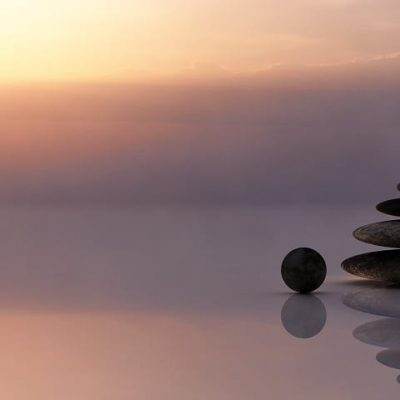 Stones balanced in a photo of sunset
